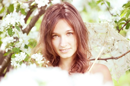 The image of a beautiful girl in the lush spring garden Stock Photo - 10705358