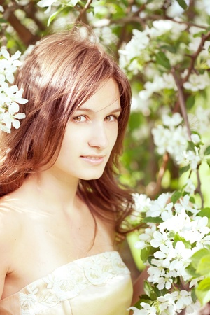 The image of a beautiful girl in the lush spring garden Stock Photo - 10705368