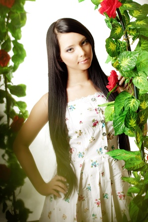 Picture of cute girl on the background of the arch entwined by roses Stock Photo - 10705321