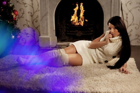 Image of the girl lying near the fireplace Stock Photo - 10705055