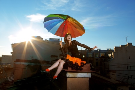 The image of a bright girl on the roof photo