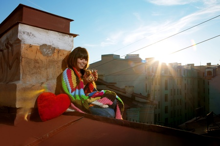 roof light: Images of girl with a cup of hot drink on the roof