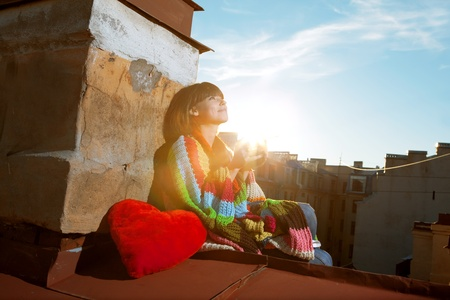 Images of girl with a cup of hot drink on the roof Stock Photo - 10705196