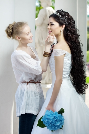 Image of the stylist takes care of the bride Stock Photo - 10705167