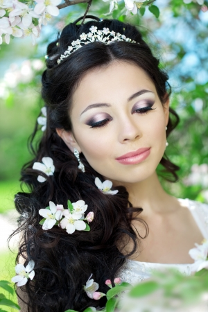 The image of a beautiful bride in a blossoming garden Stock Photo - 10705165