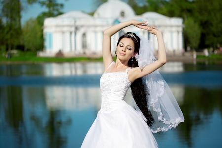 Image of luxury bride near palace photo