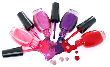 Image of bright-colored nail polish  spilling from bottles  photo