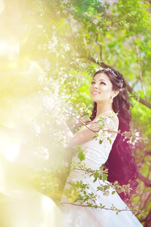 The image of a beautiful bride in a blossoming garden  Stock Photo - 11527853