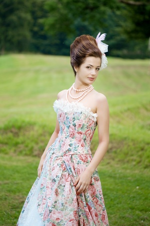 princess dress: A woman like a princess in an vintage dress in nature