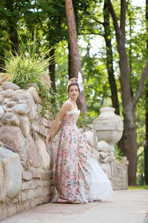 A woman like a princess in an vintage dress in nature Stock Photo - 11527593