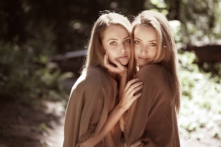 Two beautiful twins in the forest Stock Photo - 11527738