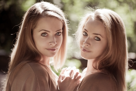 twins: Two women, twins in the forest