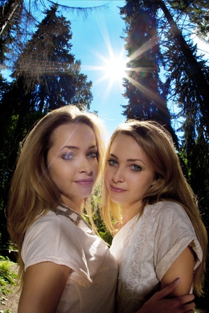 Two twins in the forest photo