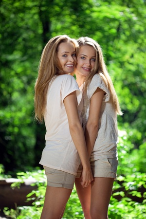 Two women, twins in the forest  photo