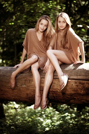 cute girlfriends: Two beautiful twins in the forest