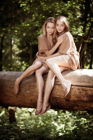 Two beautiful twins in the forest Stock Photo - 11527518