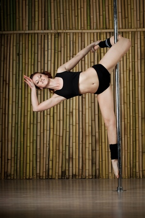 Beauty sexy pole dance woman. photo