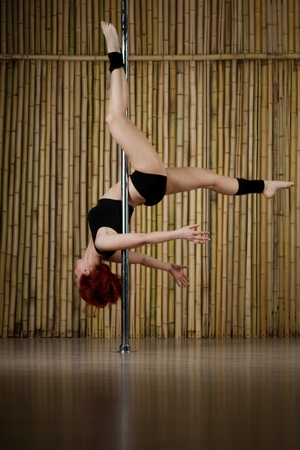 Beauty sexy pole dance woman photo