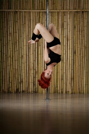 Beauty sexy pole dance woman. Stock Photo - 11527765