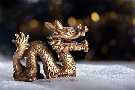 Dragon symbol of the year 2012 on a bright background photo