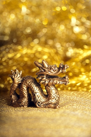 Dragon symbol of the year 2012 on a bright background bokeh photo