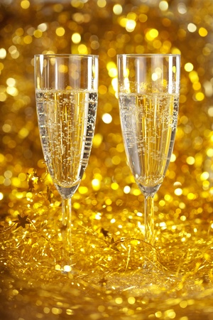 Two glasses of champagne against the gleaming bokeh photo