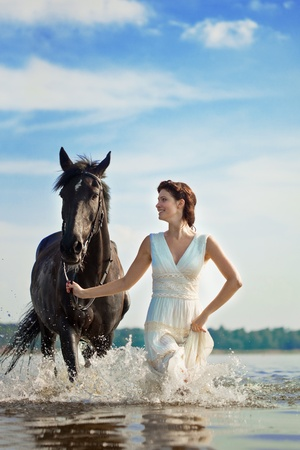 horseback: Image of a woman on a horse by the sea