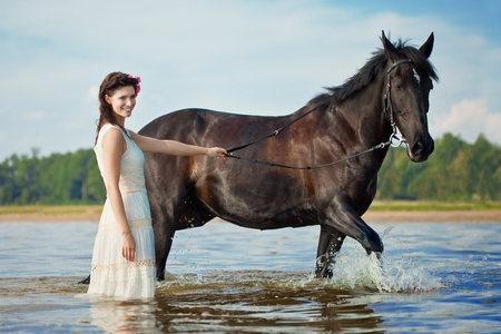 Image of a woman on a horse by the sea photo