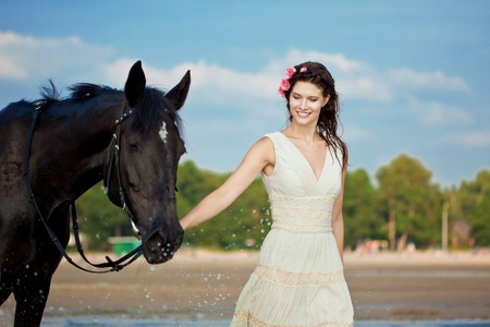 woman and horse: Image of a woman on a horse by the sea