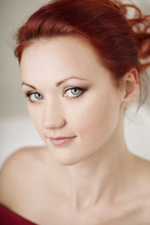 The image of the beautiful redhaired woman photo