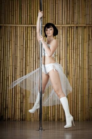 Beauty sexy pole dance woman. photo