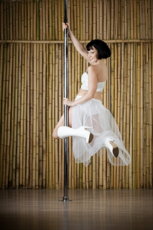 Beauty sexy pole dance woman. Stock Photo - 13917776