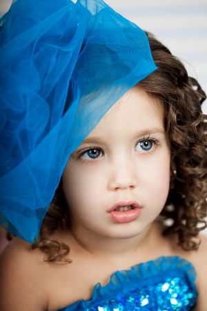 �ute little girl, a child in a gorgeous dress in the room photo