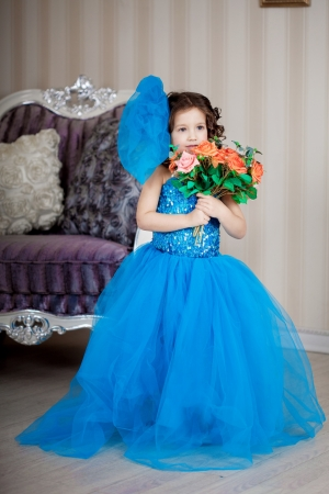 Ñute little girl, a child in a gorgeous dress in the room Stock Photo - 14551870