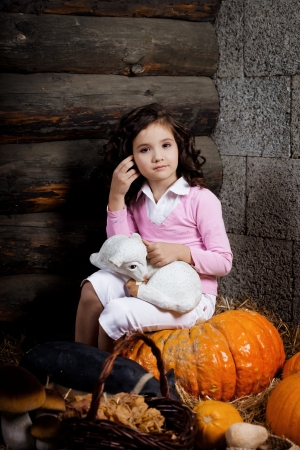 Beautiful little girl, a child on the farm photo