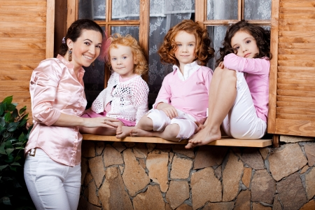 The image of three little girls, cute kids with mother photo