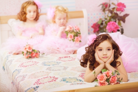 The image of children in the nursery in pink dresses Banco de Imagens