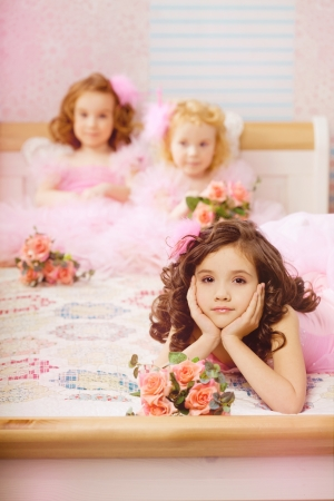 The image of children in the nursery in pink dresses photo