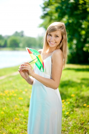 Beautiful smiling woman with a rainbow umbrella outdoors  photo