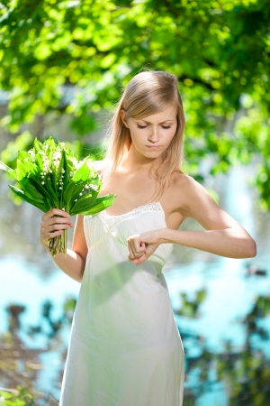 Young beautiful artistic woman with flowers outdoors photo
