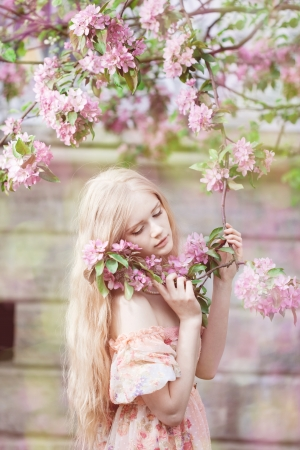 Beautiful woman with flowering tree photo