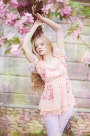 Beautiful woman and flowering tree photo