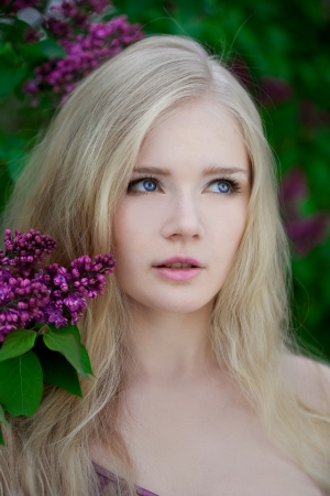Luxury woman with a lilac flowers. photo