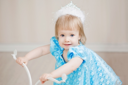 Cute girl, a child in a blue dress photo
