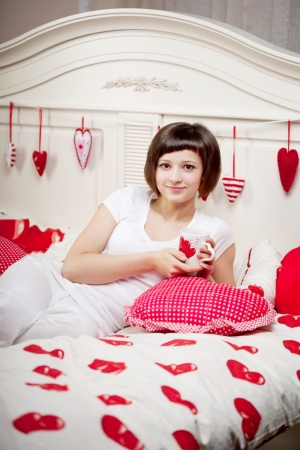 Beautiful woman in bed with hearts Stock Photo - 14797695