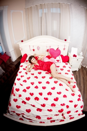 Beautiful woman in bed with hearts Stock Photo - 14723246