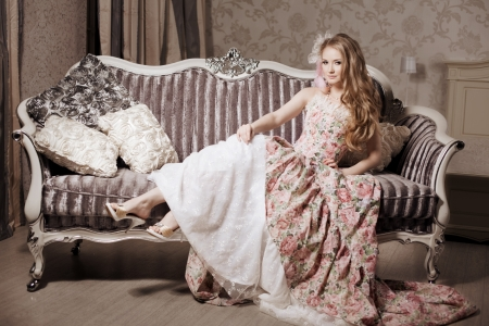 Stylish woman in a vintage dress in a luxurious interior photo