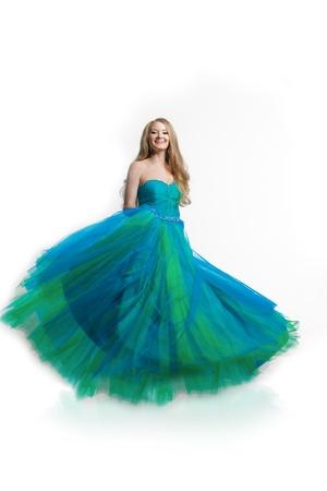 avantegarde: Stylish woman in a blue dress on a white background