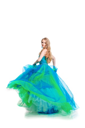 dress blowing in the wind: Stylish woman in a blue dress on a white background
