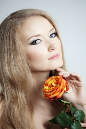 Beautiful woman with a rose in his hand Stock Photo - 14797715